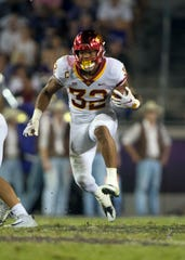 Iowa State Cyclones running back David Montgomery (32) runs against the TCU Horned Frogs defense during the second half at Amon G. Carter Stadium.