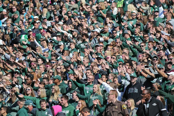 Michigan State fans cheer during the win over Central Michigan.