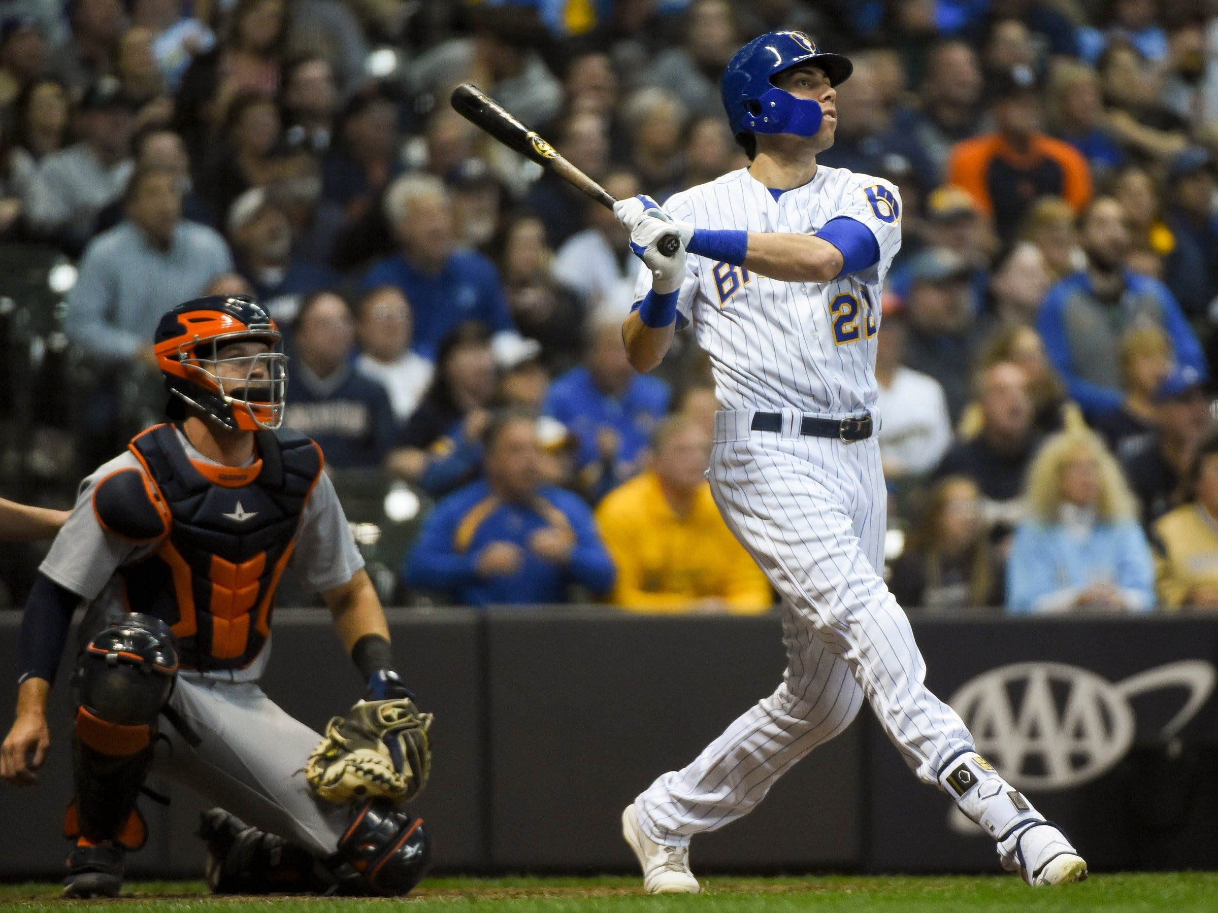 Milwaukee Brewers right fielder Christian Yelich hits a solo home run in the seventh inning, as Detroit Tigers catcher Grayson Greiner watches at Miller Park, Sept. 29, 2018 in Milwaukee.