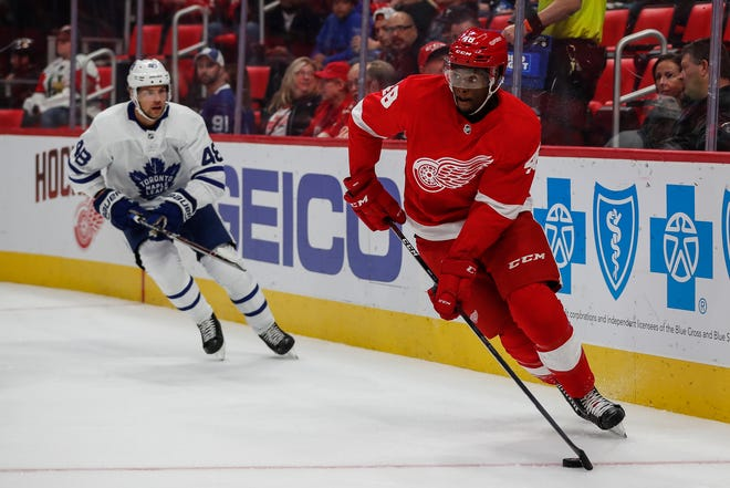 Red Wings defenseman Givani Smith passes against the Maple Leafs during the first period Saturday.