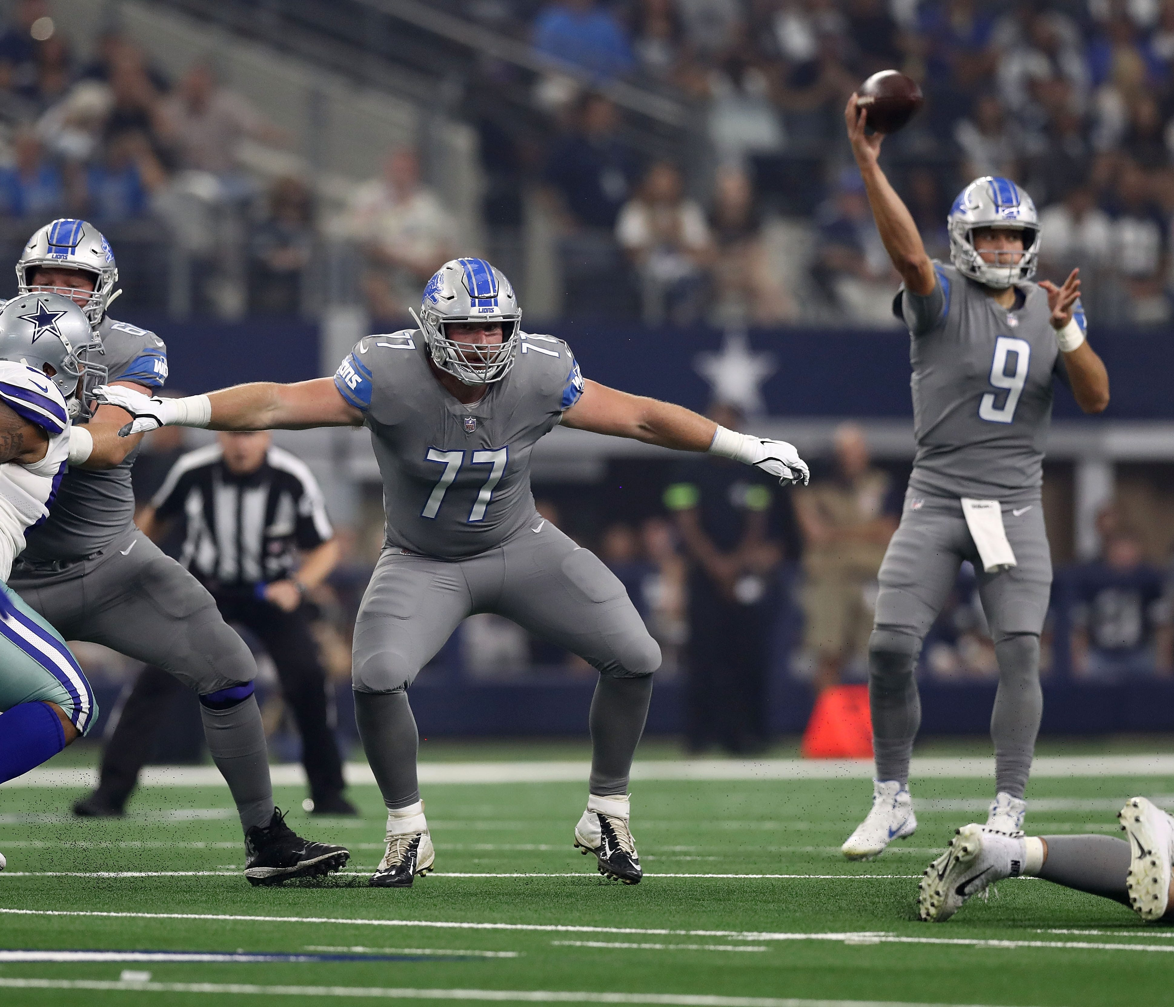 Lions offensive lineman Frank Ragnow protects quarterback Matthew Stafford as he passes in the first quarter in Arlington, Texas, Sunday, Sept. 30, 2018.