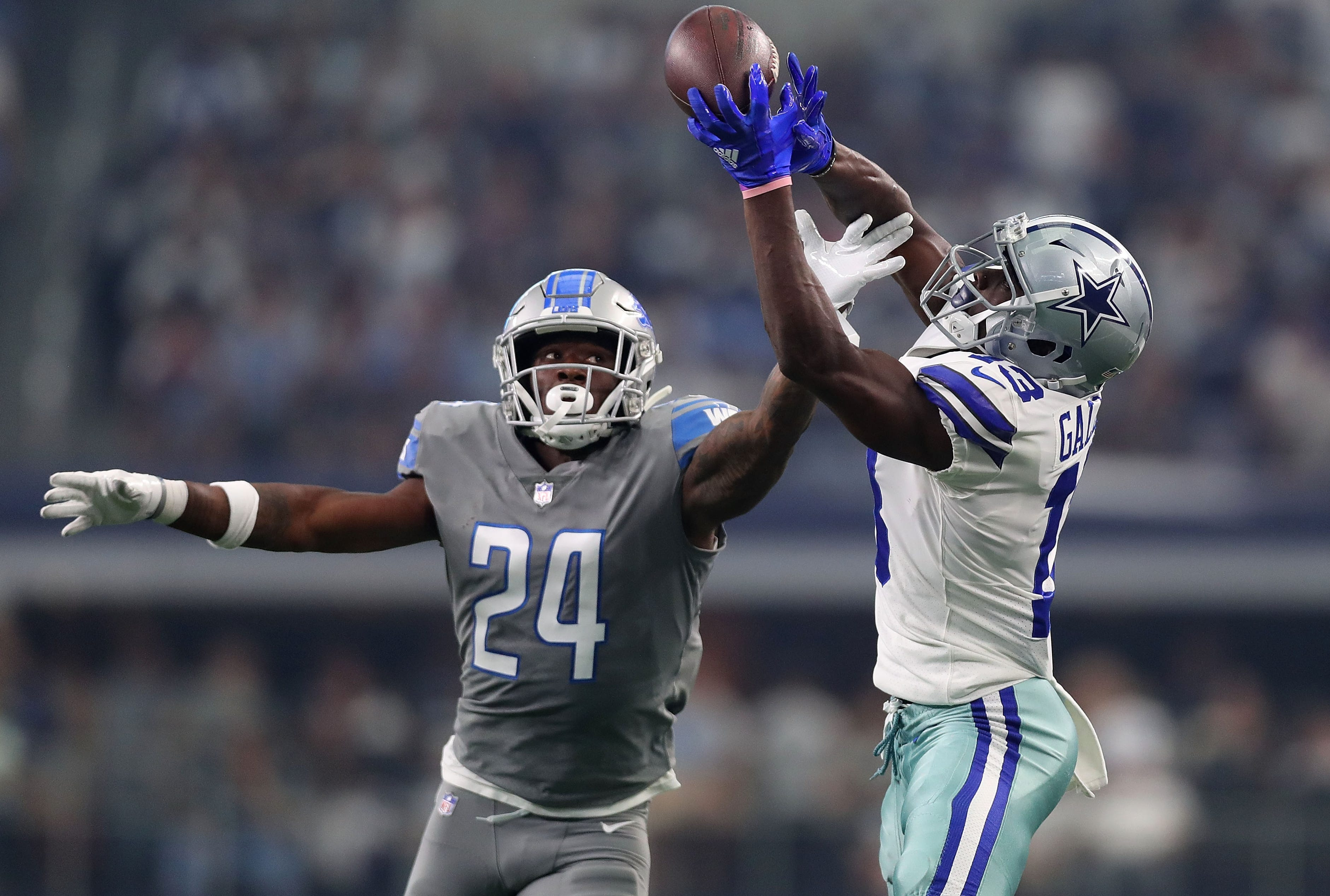 Lions cornerback Nevin Lawson tries to break up the pass caught by Cowboys wide receiver Michael Gallup in the first quarter in Arlington, Texas, Sunday, Sept. 30, 2018.