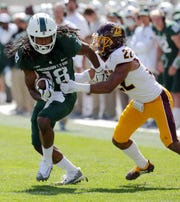 Michigan State receiver Felton Davis III makes a catch against Central Michigan cornerback Xavier Crawford during second half action Saturday, September 29, 2018 at Spartan Stadium in East Lansing, Mich.