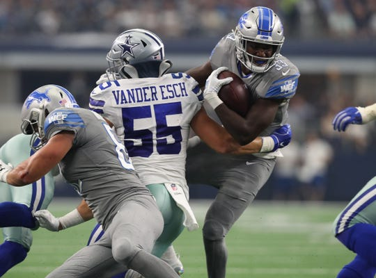 Lions running back Kerryon Johnson runs with the ball in the second quarter against Cowboys linebacker Leighton Vander Esch on Sunday, Sept. 30, 2018, in Arlington, Texas.