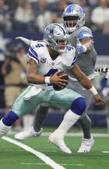Cowboys quarterback Dak Prescott avoids pressure from Lions defensive end Romeo Okwara in Arlington, Texas, Sunday, Sept. 30, 2018.