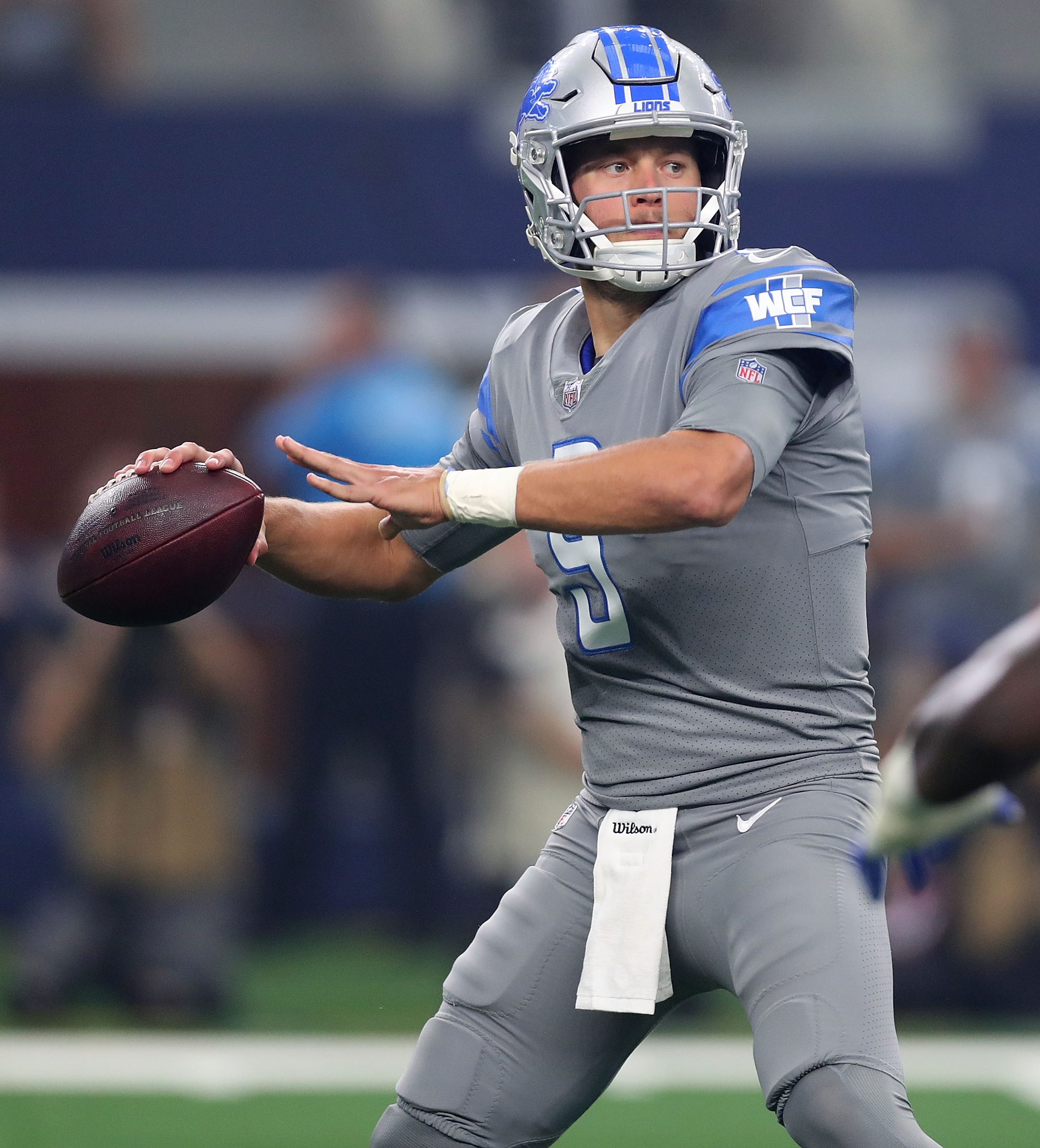 Matthew Stafford looks to pass against the Cowboys in the first quarter.