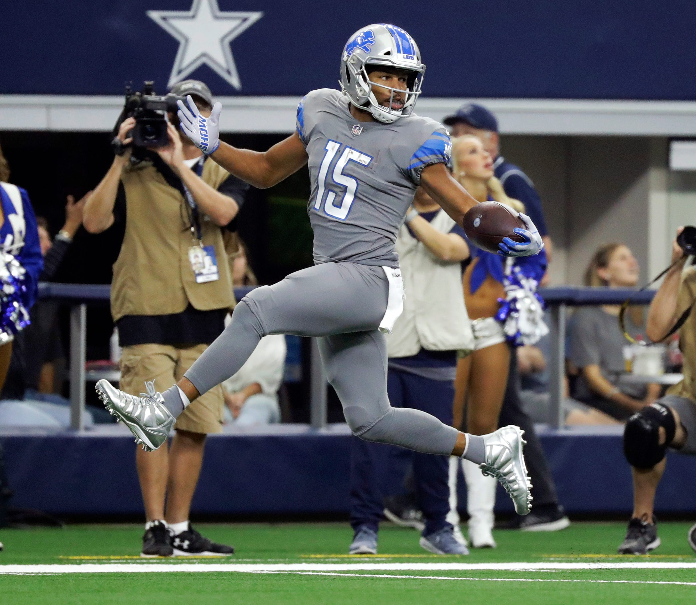 Lions wide receiver Golden Tate looks over his shoulder on a touchdown run on a pass from Matthew Stafford in the first half in Arlington, Texas, Sunday, Sept. 30, 2018.