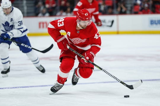 Red Wings forward Darren Helm skates into the Maple Leafs zone during the second period of a preseason game at Little Caesars Arena in Detroit, Saturday, Sept. 29, 2018.