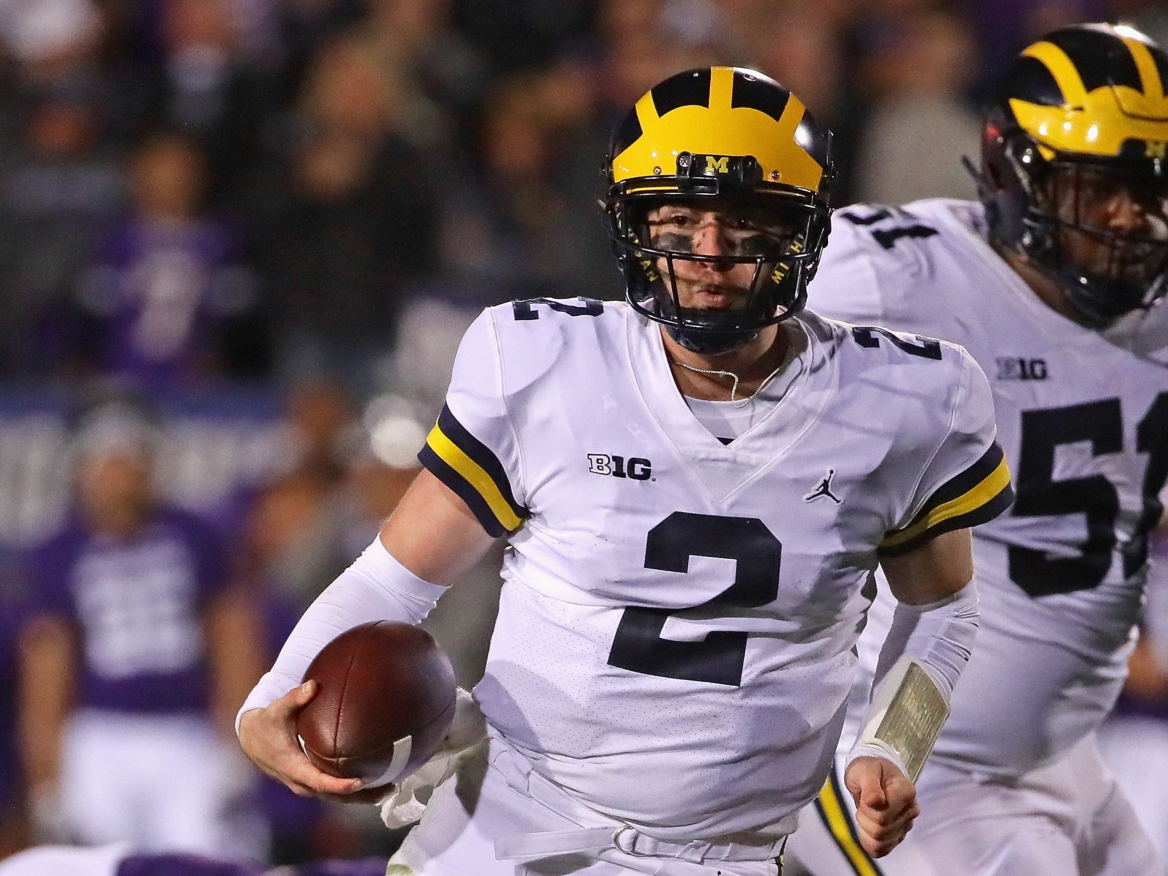 Michigan's Shea Patterson runs for a first down against Northwestern at Ryan Field on Sept. 29, 2018 in Evanston, Ill.