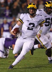 Michigan's Shea Patterson runs for a first down against Northwestern.
