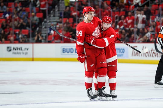 Red Wings' Matt Puempel (54) celebrates his goal with Joe Hicketts (2) during the second period of a preseason game against the Maple Leafs at Little Caesars Arena in Detroit, Saturday, Sept. 29, 2018.