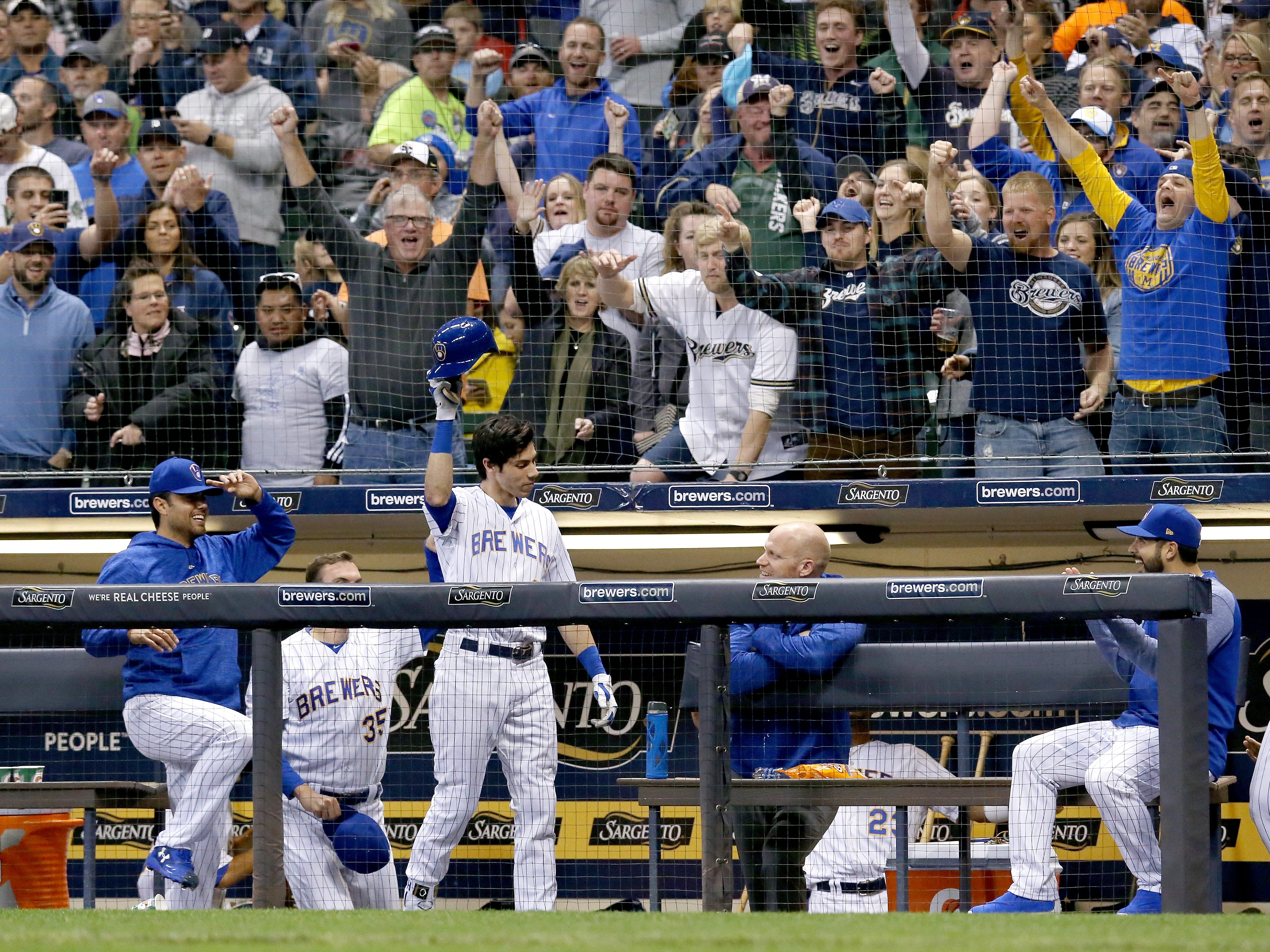 Christian Yelich of the Milwaukee Brewers takes a curtain call after hitting a home run in the seventh inning against the Detroit Tigers at Miller Park on Sept. 29, 2018 in Milwaukee.