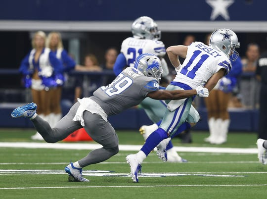 Cowboys receiver Cole Beasley is tackled after a catch by Lions cornerback Jamal Agnew during the second half.
