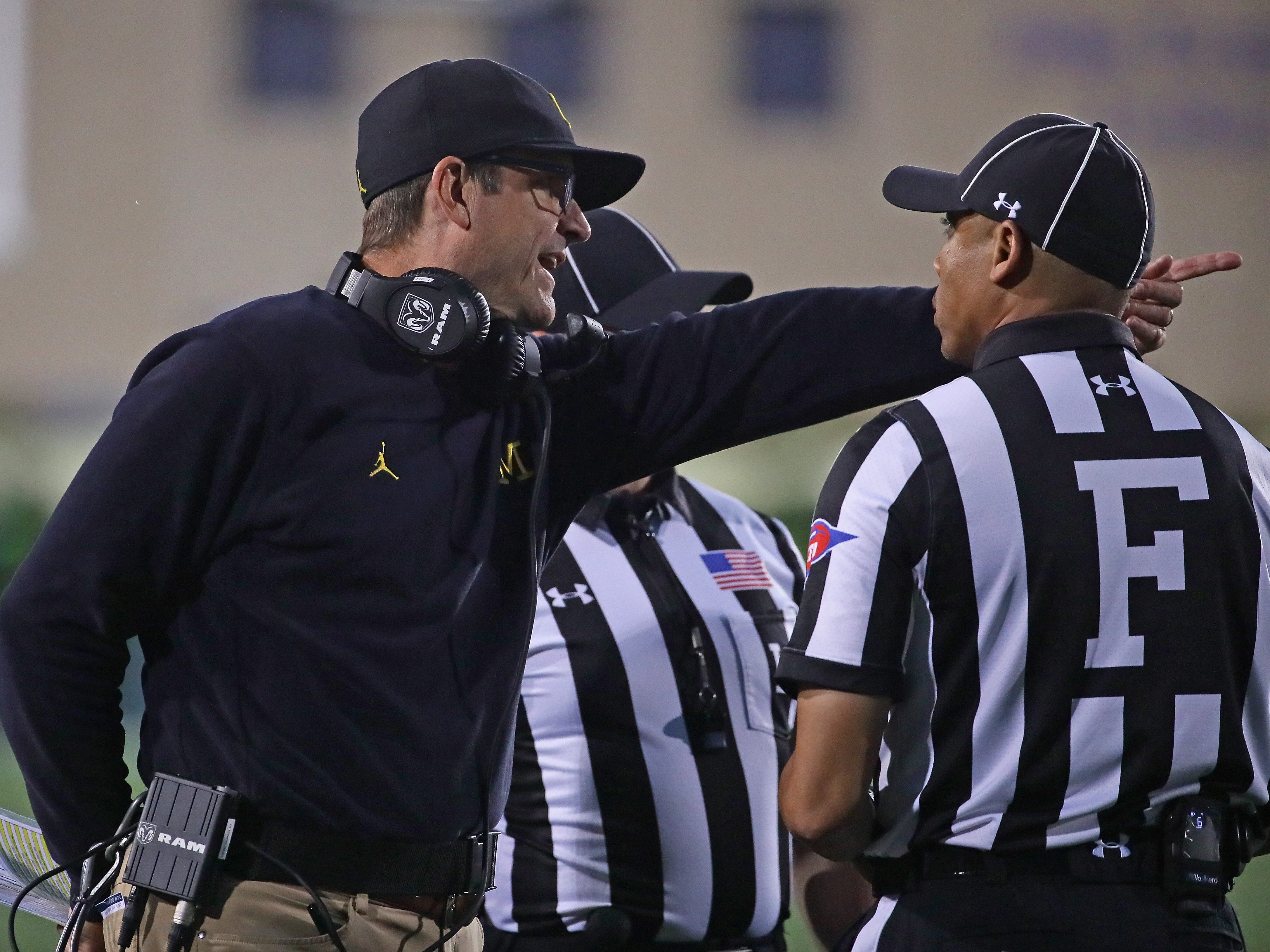 Michigan coach Jim Harbaugh argues with referees against Northwestern at Ryan Field on Sept. 29, 2018 in Evanston, Ill.