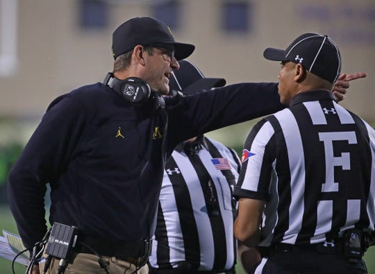 Jim Harbaugh argues with referees against Northwestern.