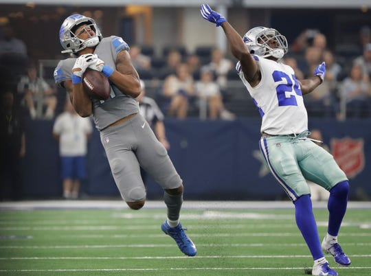 Lions wide receiver Marvin Jones catches a pass in front of Cowboys cornerback Chidobe Awuzie in the first half in Arlington, Texas, Sunday, Sept. 30, 2018.
