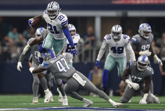 Dallas Cowboys' Ezekiel Elliott jumps over Detroit Lions' Tracy Walker in the fourth quarter at AT&T Stadium on Sept. 30, 2018 in Arlington, Texas.
