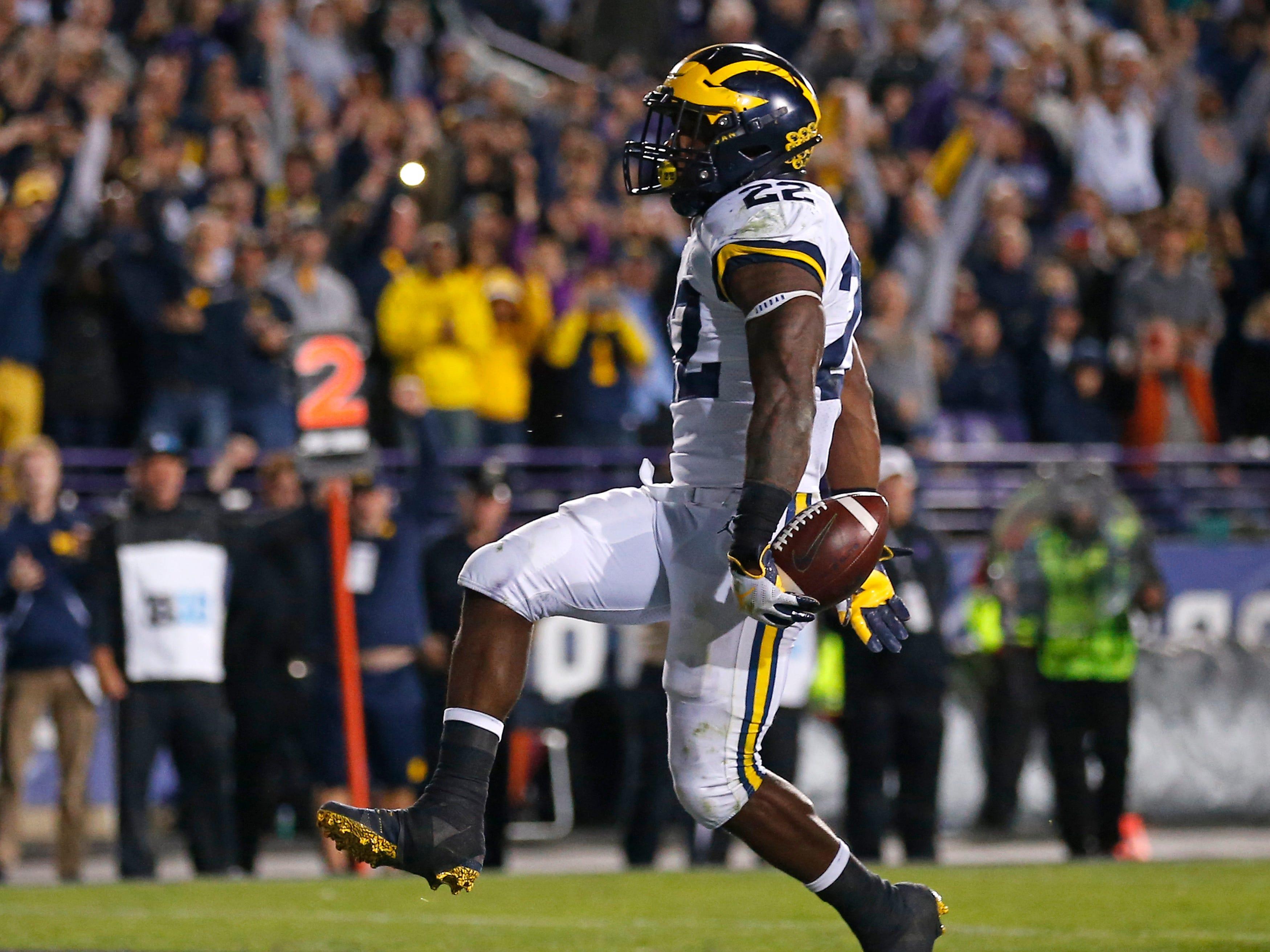 Michigan's Karan Higdon scores the go-ahead touchdown against Northwestern during the fourth quarter Saturday, Sept. 29, 2018, in Evanston, Ill.