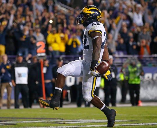 Karan Higdon scores the go-ahead touchdown in the fourth quarter.