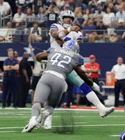 Cowboys quarterback Dak Prescott, rear, is tackled by Detroit Lions linebacker Devon Kennard after a pass in the second half of the Lions' 26-24 loss on Sunday, Sept. 30, 2018, in Arlington, Texas.