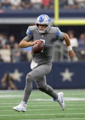 Lions quarterback Matthew Stafford runs with the ball in the second quarter on Sunday, Sept. 30, 2018, in Arlington, Texas.