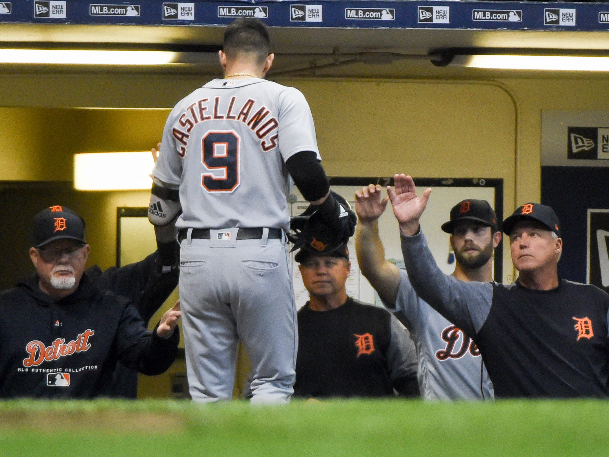 Detroit Tigers right fielder Nicholas Castellanos is greeted by manager Ron Gardenhire, left, after hitting a solo home run in the fifth inning against the Milwaukee Brewers at Miller Park on Sept. 29, 2018 in Milwaukee.
