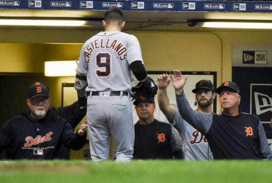 Nicholas Castellanos is greeted by manager Ron Gardenhire, left, after hitting a home run against the Brewers at Miller Park on Sept. 29, 2018 in Milwaukee.