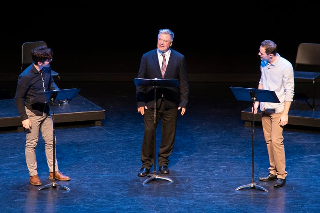 Actor Alec Baldwin, center, performs with University of Michigan Department of Theatre and Drama students Nico Dangla, left, and Jack Alberts, right, during a dramatic reading of Arthur Miller's Death of a Salesman at the Power Center on Saturday, September 29 in Ann Arbor.
