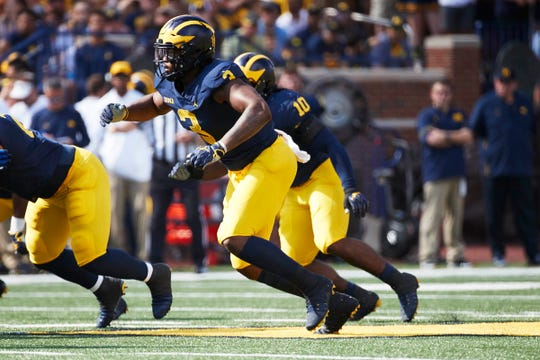 Michigan defensive end Rashan Gary rushes in the first half against Southern Methodist at Michigan Stadium on Sept. 15, 2018.
