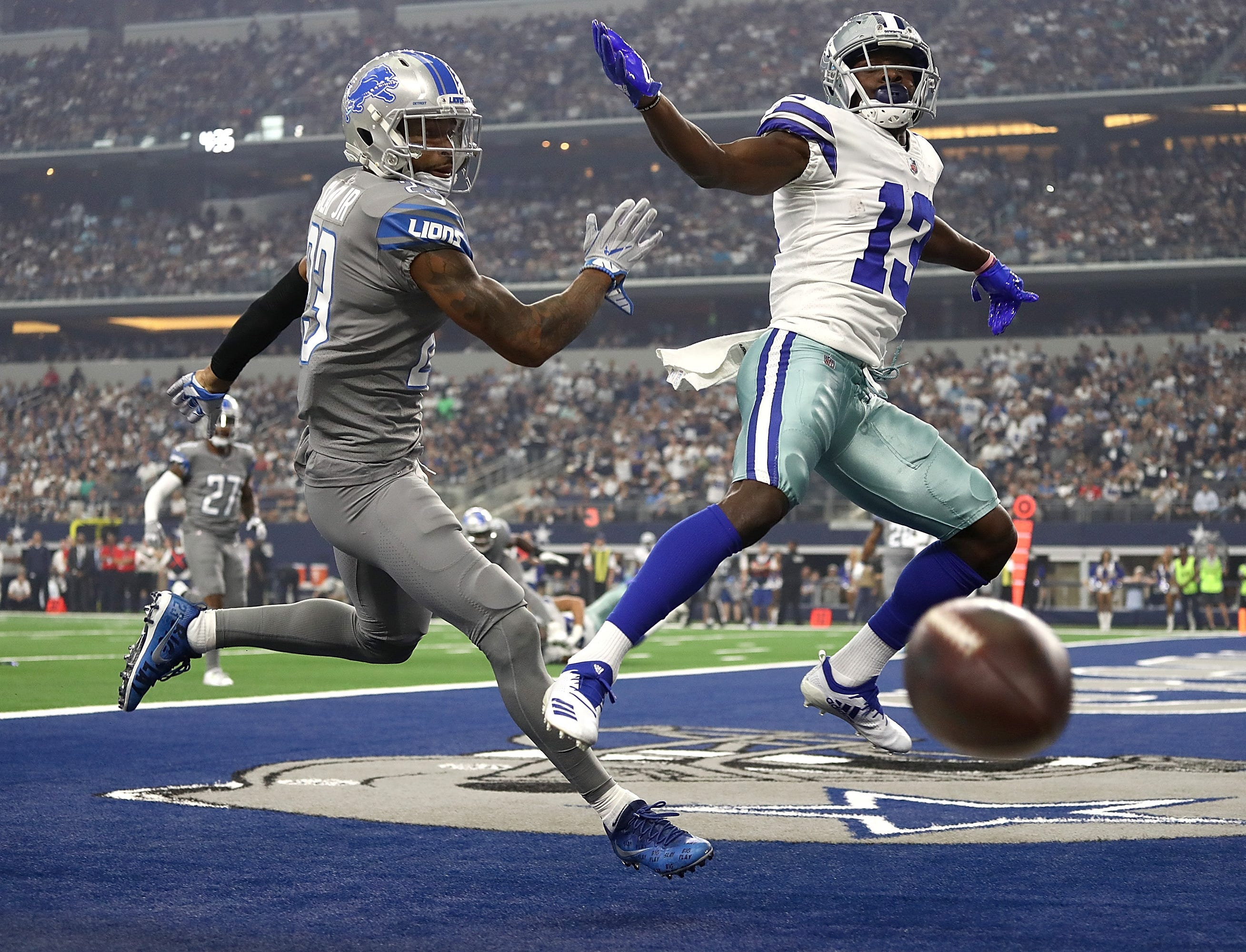 Cowboys wide receiver Michael Gallup goes up for a pass against Lions cornerback Darius Slay in the first quarter in Arlington, Texas, Sunday, Sept. 30, 2018.
