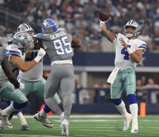 Cowboys quarterback Dak Prescott (4) throws in the pocket in the first quarter in Arlington, Texas, Sunday, Sept. 30, 2018.