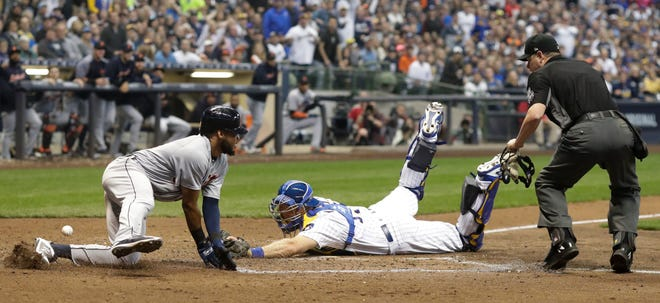 Dawel Lugo scores safely past Brewers catcher Erik Kratz during the sixth inning Saturday. Lugo scored from third on a sacrifice fly.
