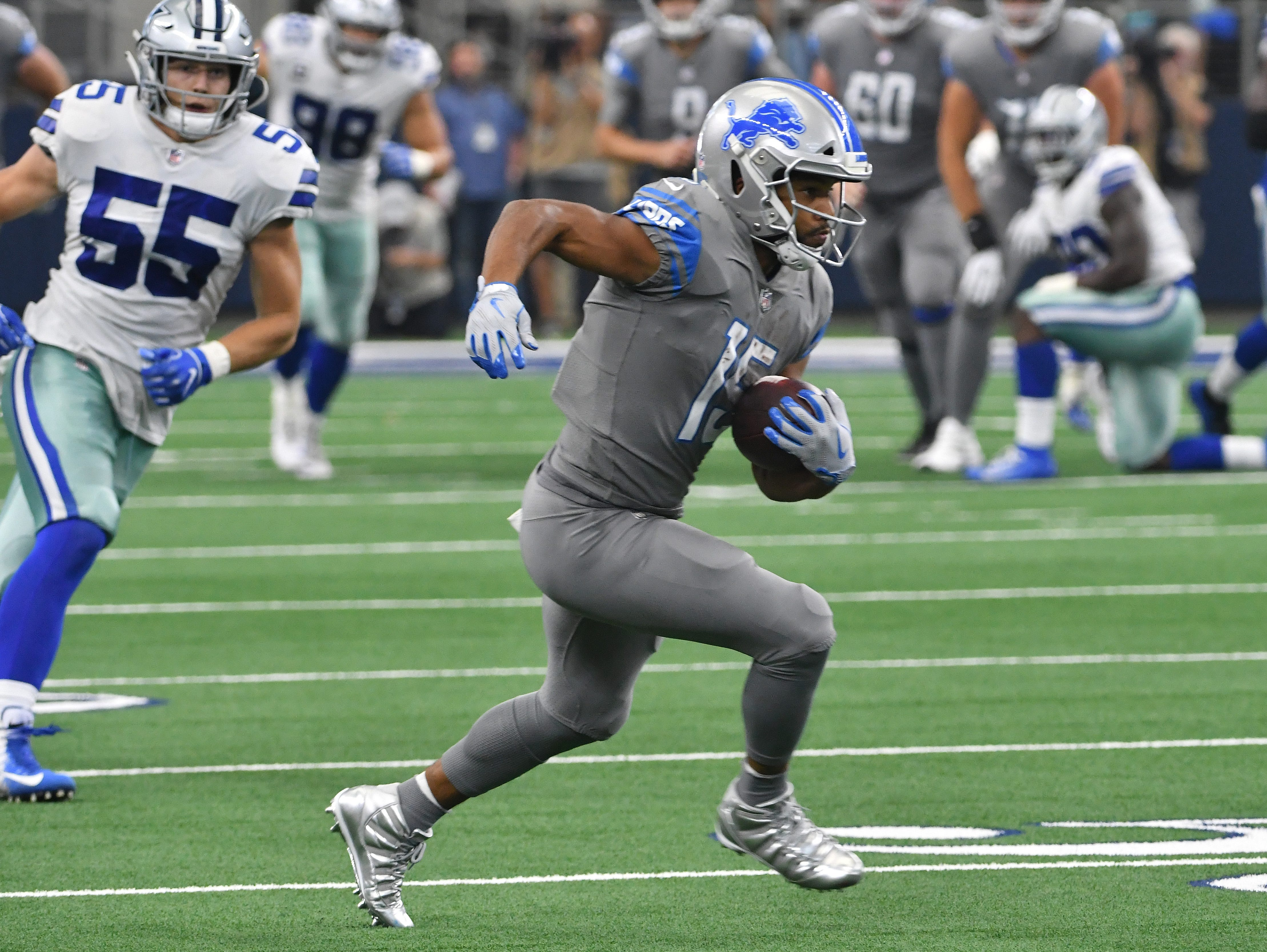 Lions wide receiver Golden Tate scrambles up field for a first down late in the fourth quarter.