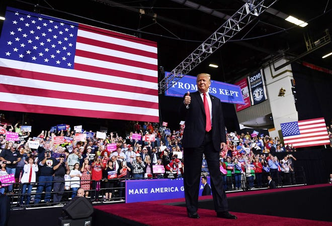 President Donald Trump gives a thumbs up during a rally at WesBanco Arena in Wheeling, West Virginia on September 29, 2018.