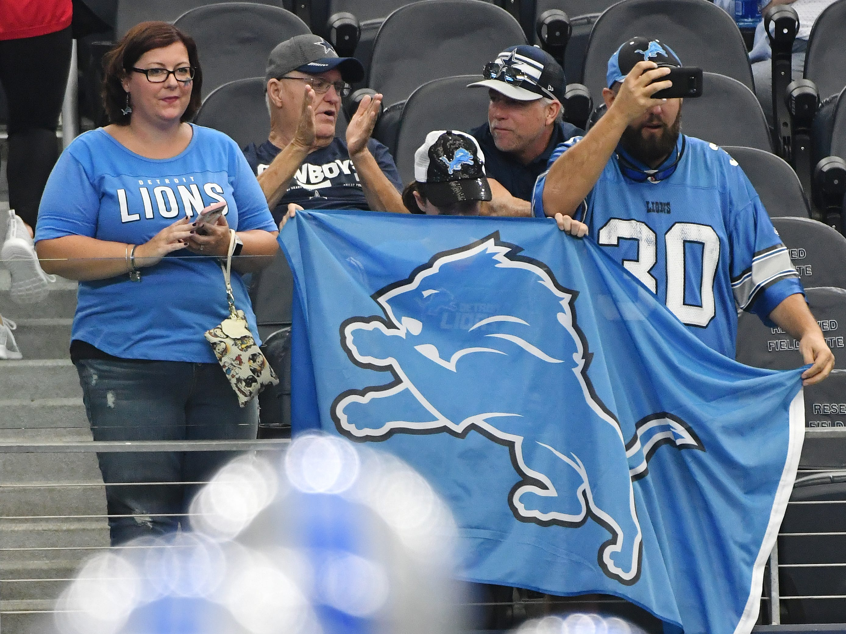 Lions fans in the stands in Texas as Detroit warms up before taking on the Cowboys in Arlington.