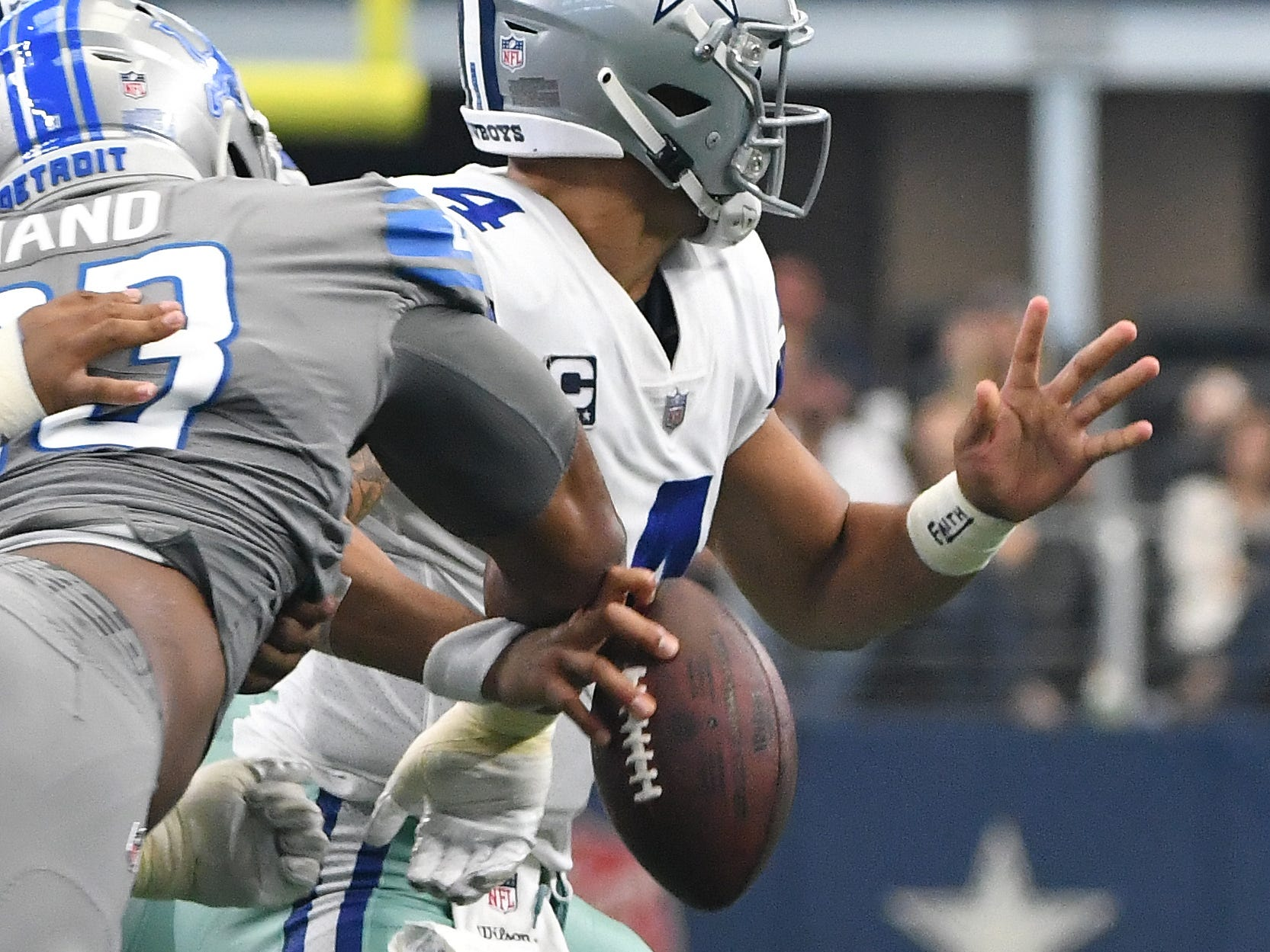Lions defensive lineman Da'Shawn Hand gets a hand on Cowboys quarterback Das Prescott's hand, forcing the fumble which Prescott was able to recover and then throw it away to avoid the loss yardage on the final drive of the game in the fourth quarter.