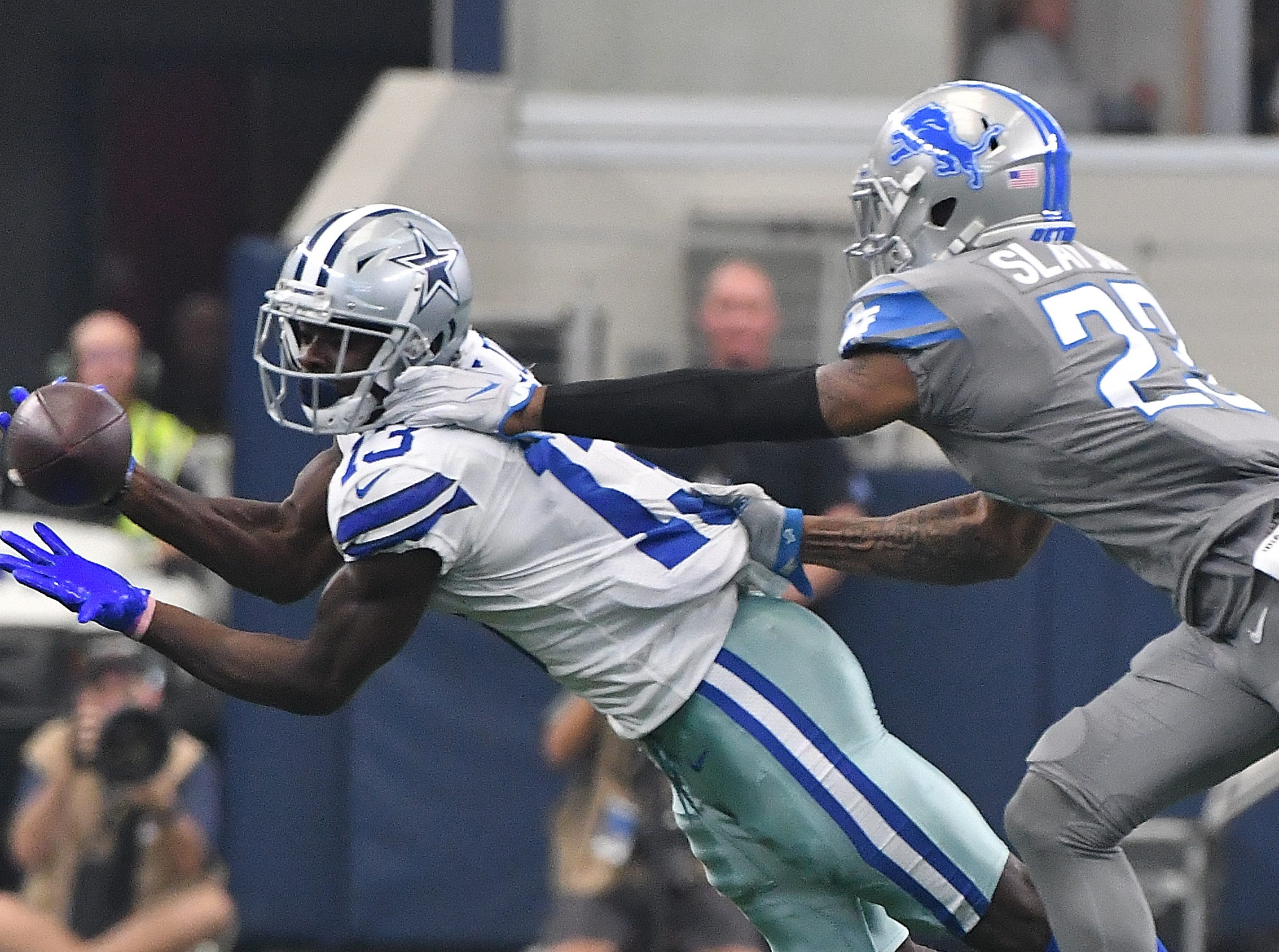 Cowboys' Michael Gallup can't hang onto a long reception with Lions' Darius Slay defending in the fourth quarter.  NFL Detroit Lions vs. Dallas Cowboys at AT&T Stadium in Arlington, Texas on September 30, 2018. (Image by Daniel Mears / The Detroit News)