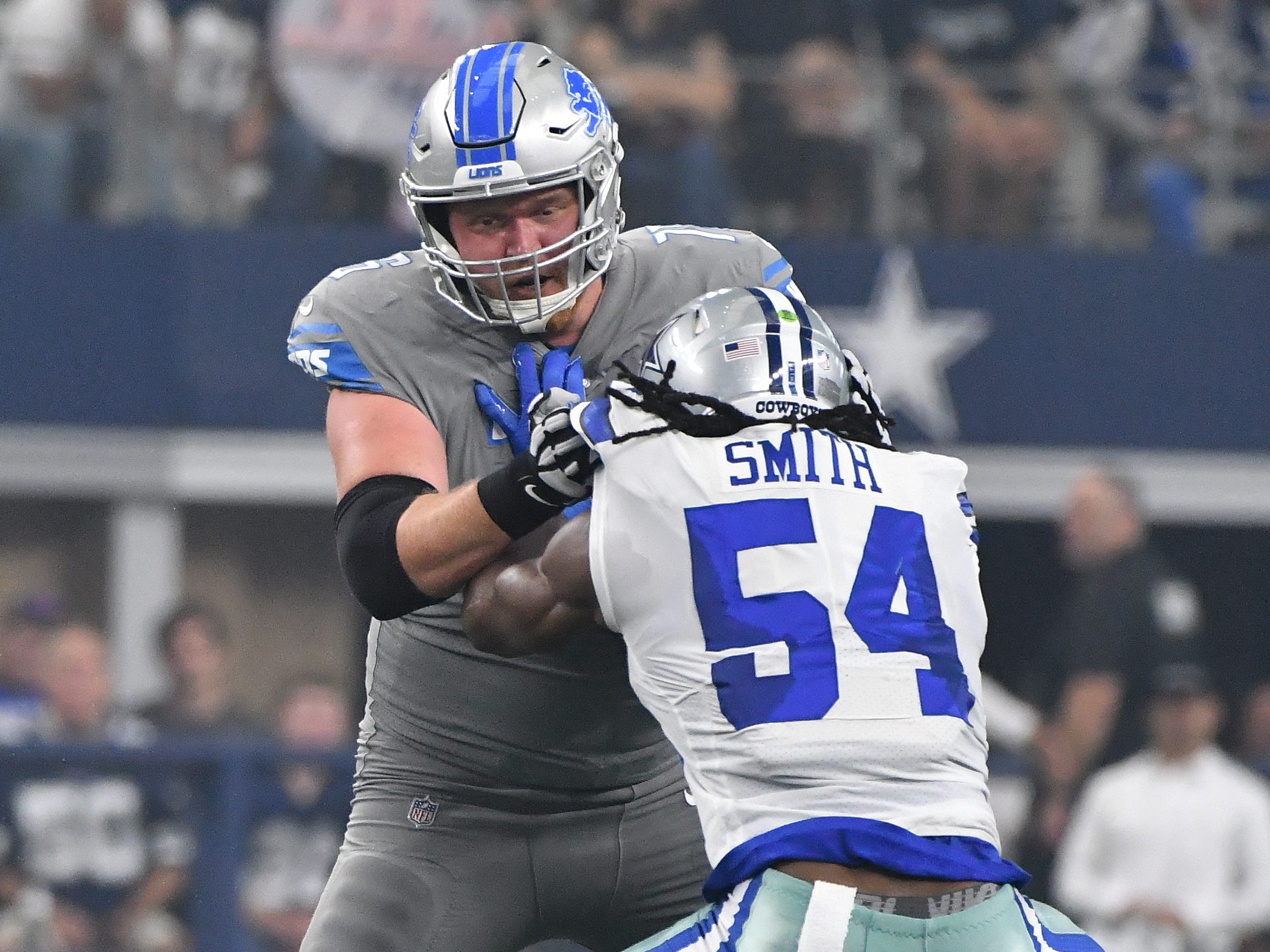 Lions T.J. Lang works against Cowboys' Jaylon Smith in the first quarter.  Lang went out of the game after this play in the first quarter.