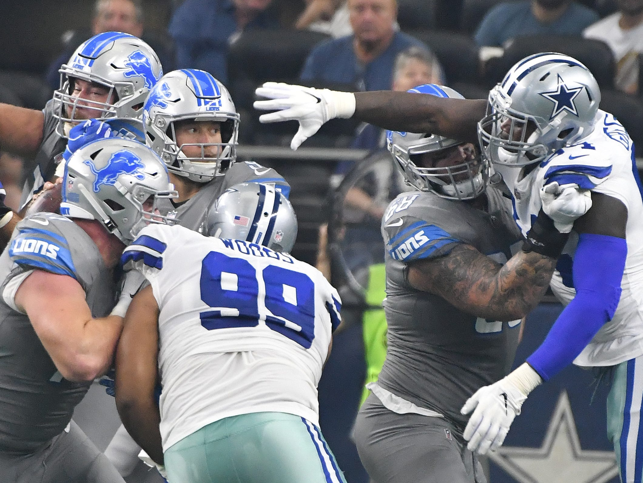 Lions quarterback Matthew Stafford feels some pressure from Cowboys' Randy Gregory in the first quarter.