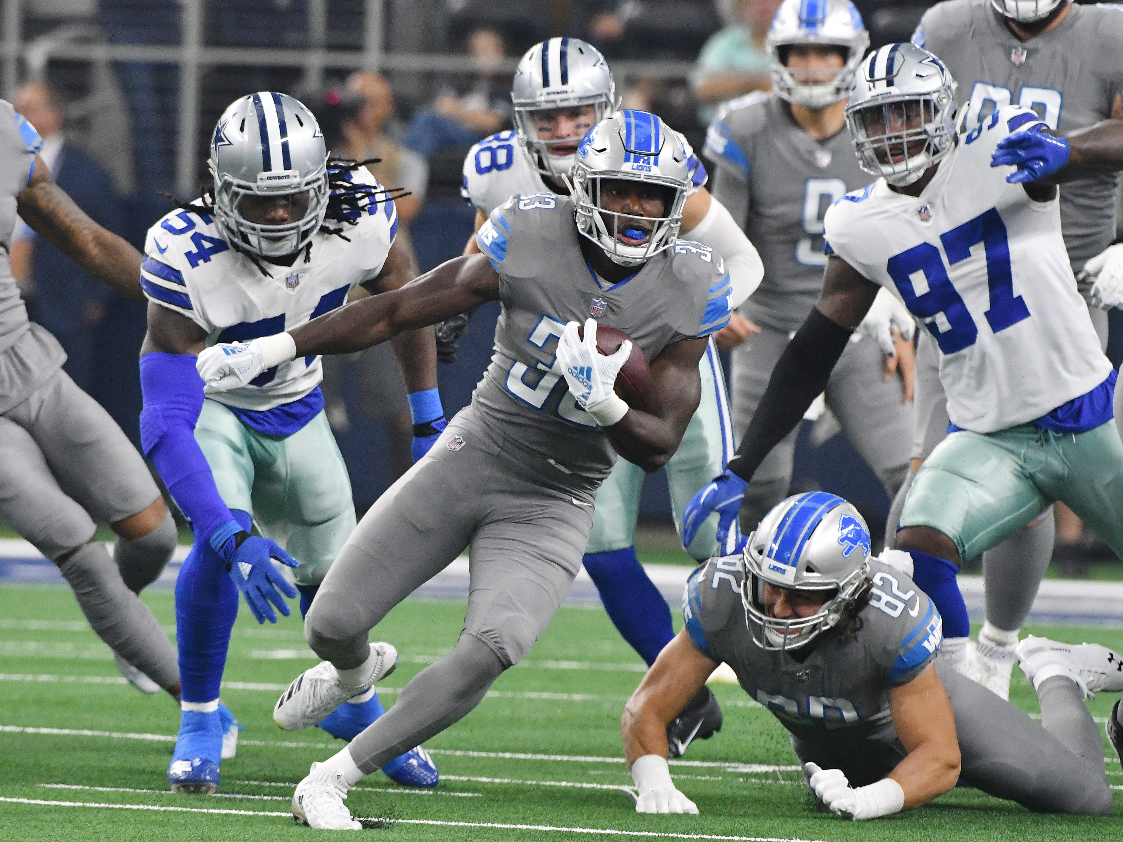Lions running back Kerryon Johnson takes the first Detroit offensive play of the game and takes it down field for a long first down in the first quarter.
