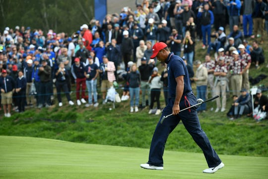 Tiger Woods walks during his singles match Sunday. He didn't win a match during this year's Ryder Cup.