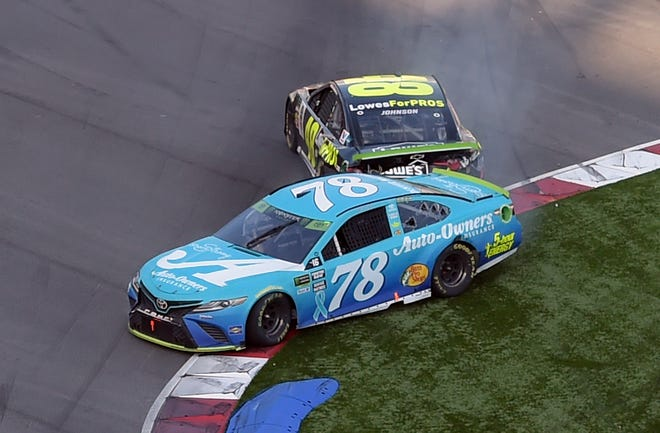 Martin Truex Jr. (78) is hit by Jimmie Johnson during the last lap of Sunday's NASCAR Cup series race at Charlotte Motor Speedway.