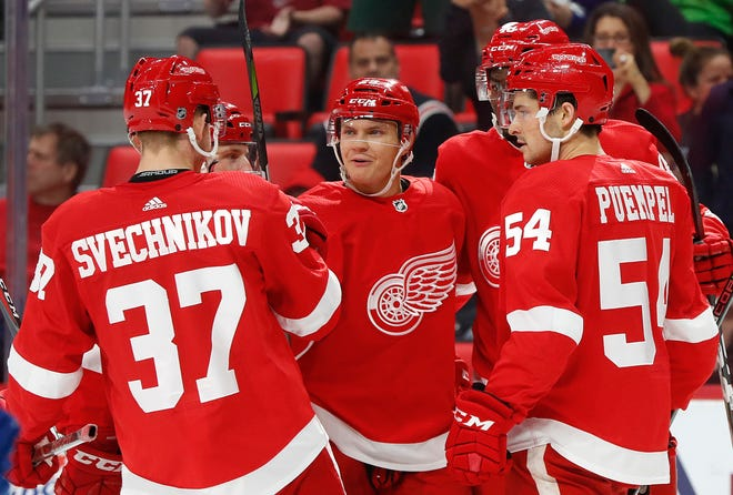 Detroit Red Wings Vili Saarijarvi, second from left, celebrates scoring a goal against the Toronto Maple Leafs in the first period.