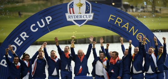 Europe's winning Ryder Cup team celebrates Sunday evening in France.