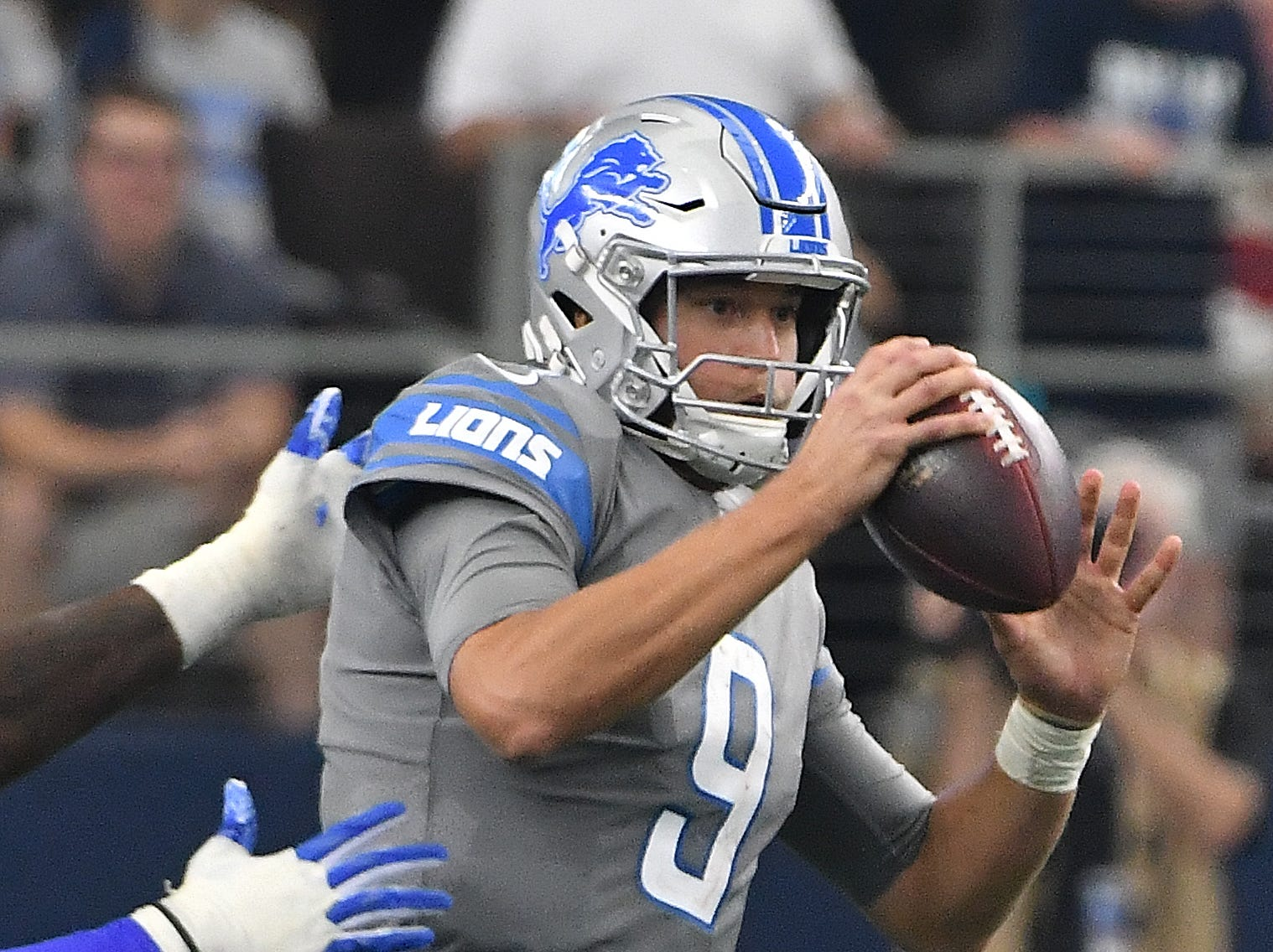 Lions'Matthew Stafford feels the pressure from Cowboys' DeMarcus Lawrence who sack the quarterback in the fourth quarter.