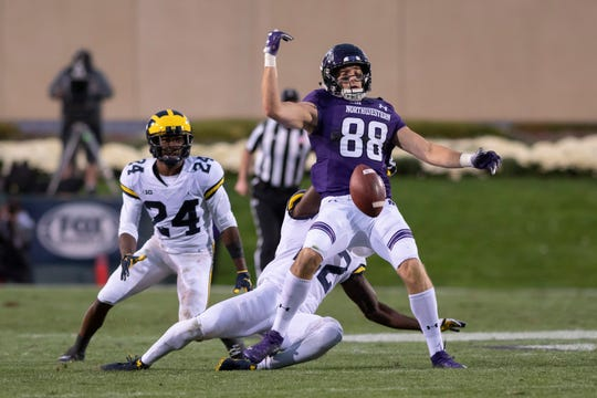 Northwestern wide receiver Bennett Skowronek can't hold onto a pass while under pressure from Michigan defensive back Lavert Hill, left, and defensive back David Long in the fourth quarter last week.