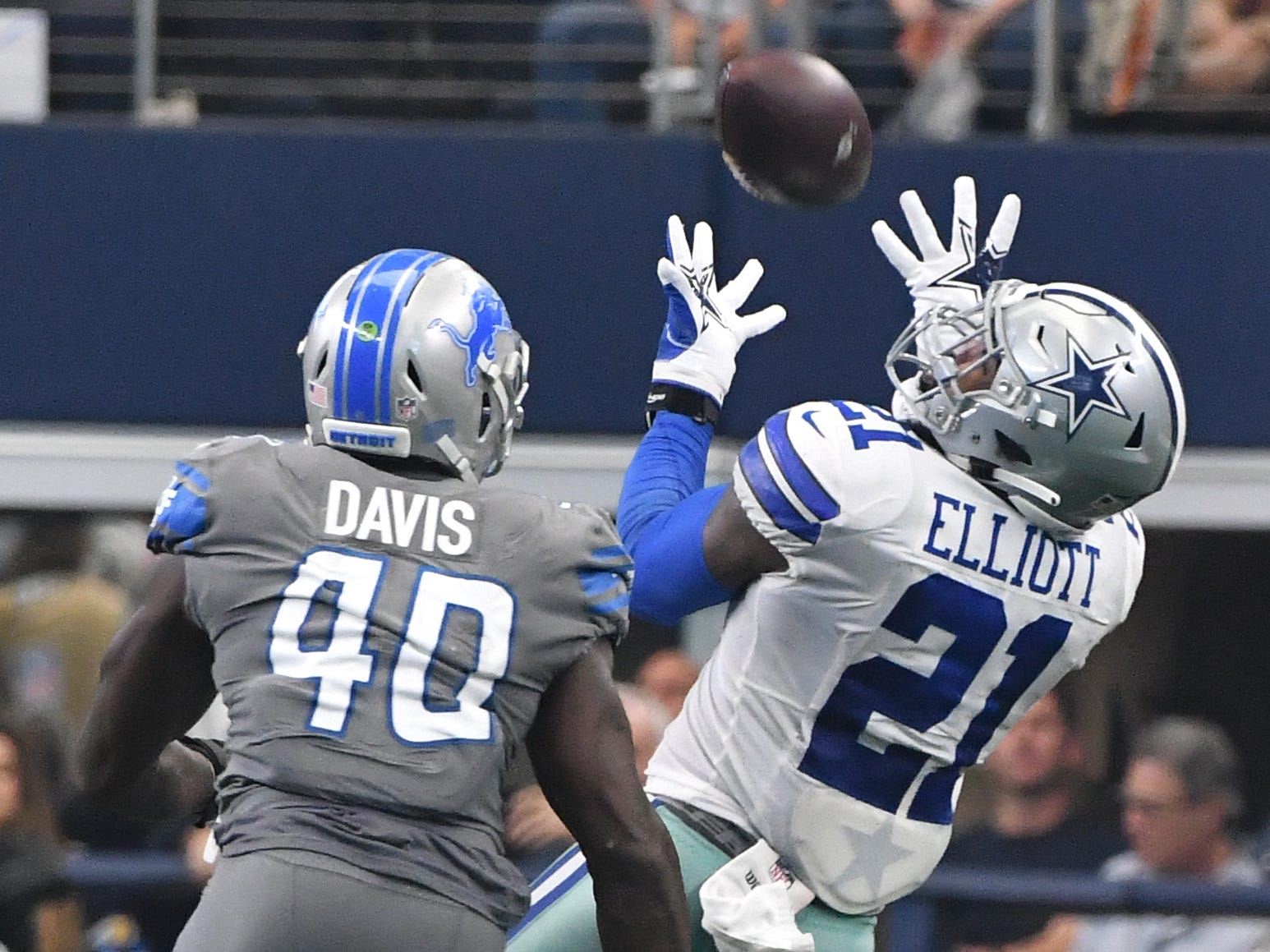 Cowboys running back Ezekiel Elliott makes a long over-the-shoulder reception to put Dallas well within game winning field goal range which is exactly what happened to end the game, 26-24 over the Detroit Lions at AT&T Stadium in Arlington, Texas on September 30, 2018.