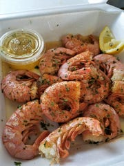 Any seafood from Bubba Gandy can be steamed to go, such as these jumbo Gulf shrimp with garlic butter and lemon.