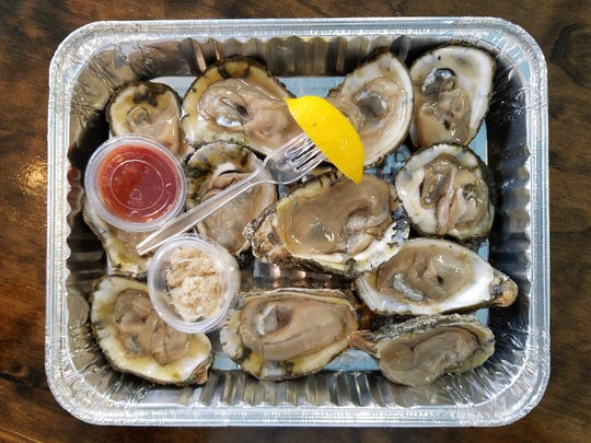 Fresh gulf oysters by the dozen, shucked while you watch at Bubba Gandy.
