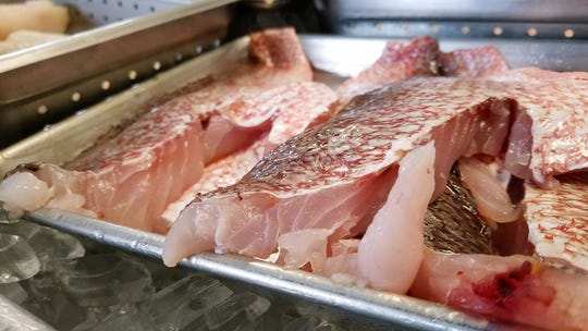 Fresh red snapper, a favorite gulf fish for blackening, freshly-cut and on ice at Bubba Gandy.